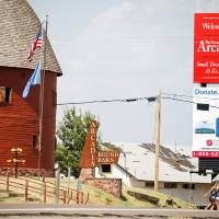Photo - A billboard is seen in July near Arcadia's Round Barn. OKLAHOMAN ARCHIVEs PHOTO