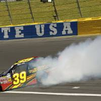 Photo - Ryan Sieg (39) spins out of control after driving through turn two during the NASCAR Nationwide series History 300 auto race at Charlotte Motor Speedway in Concord, N.C., Saturday, May 24, 2014. (AP Photo/Chris Keane)