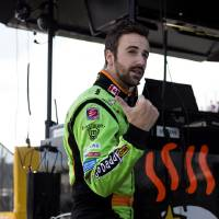Photo - Canadian James Hinchcliffe talks to a crew member in the pits during a practice session for the IndyCar Honda Indy Toronto auto race in Toronto, Friday July 12 , 2013. (AP Photo/The Canadian Press, Chris Young)