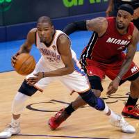 Photo -  Oklahoma City's Kevin Durant (35) drives past Miami's LeBron James (6) during Game 1 of the NBA Finals between the Oklahoma City Thunder and the Miami Heat at Chesapeake Energy Arena in Oklahoma City, Tuesday, June 12, 2012. Photo by Sarah Phipps, The Oklahoman
