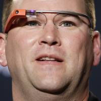 Photo - FILE - In a Friday, Dec. 27, 2013 file photo, Stanford offensive coordinator Mike Bloomgren, wearing Google Glass, answers questions from the media during a news conference, in Los Angeles. Will 2014 be remembered as the year wearable computing took off? Even with the possibilities these devices offer today, gadget lovers can expect technology companies to stretch the wearable concept further in Las Vegas at the International CES event Jan. 7-10, 2014, the industry's annual trade show. (AP Photo/Jae C. Hong, File)