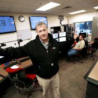 Photo - University of Oklahoma facilities manager Brian Ellis shows the modern control room in the new power, heat and air conditioning facility as he shows energy saving enhancements to the Norman campus.  Photo by Steve Sisney, The Oklahoman