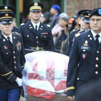 Photo - Honor guard carries the flag draped coffin during the funeral for 2nd Lt Jered Ewy, 33, of Edmond, at Henderson Hills Baptist Church.  David McDaniel - THE OKLAHOMAN