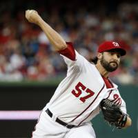 Photo - Washington Nationals starting pitcher Tanner Roark  throws during the third inning of a baseball game against the New York Mets at Nationals Park Friday, May 16, 2014, in Washington. (AP Photo/Alex Brandon)