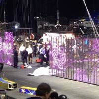 Photo - In a cell phone photo provided by Tara Griggs, emergency workers tend to injured performers after a platform collapsed, Sunday, May 4, 2014, during the Ringling Brothers and Barnum and Bailey Circus' Legends show at the Dunkin' Donuts Center in Providence, R.I. At least nine people were injured in the fall, including a dancer below. Roman Garcia, general manager of the show, said the accident occurred during the