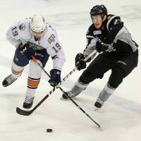 Photo - Magnus Paajarvi, of the Oklahoma City Barons, tries to get past Greg Rallo, of the San  Antonio Rampage, Dec. 28 during a game at the Cox Convention Center in Oklahoma City.  Photo by Bryan Terry, The Oklahoman Archives