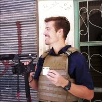Photo - This photo posted on the website freejamesfoley.org shows journalist James Foley in Aleppo, Syria, in July, 2012. The family of an American journalist says he went missing in Syria more than one month ago while covering the civil war there. A statement released online Wednesday by the family of James Foley said he was kidnapped in northwest Syria by unknown gunmen on Thanksgiving day. (AP Photo/Nicole Tung, freejamesfoley.org) NO SALES
