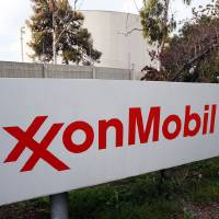 Photo - FILE - This Jan. 30, 2012 photo shows the sign for the ExxonMobil Torerance Refinery in Torrance, Calif. Exxon has once again surpassed Apple as the world's most valuable company after the iPhone and iPad maker saw its stock price falter, according to reports Friday, Jan. 25, 2013. Apple first surpassed Exxon in the summer of 2011. The two companies traded places through that fall, until Apple surpassed Exxon for good in early 2012. (AP Photo/Reed Saxon, File)