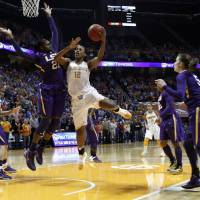 Photo - Tennessee forward Bashaara Graves (12) goes for a shot next to LSU forward Shanece McKinney (21) during the first half of an NCAA college basketball game Thursday, Jan. 2, 2014, in Knoxville, Tenn. (AP Photo/Wade Payne)