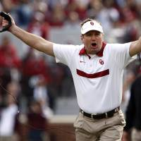 Photo - FILE - In this Nov. 5, 2011 file photo, Oklahoma coach Bob Stoops reacts to an official's call during their NCAA college football game against Texas A&M in Norman, Okla. The Sooners are ranked fourth in the Associated Press preseason college football poll released on Saturday, Aug. 18, 2012. (AP Photo/Alonzo J. Adams, File) ORG XMIT: NY157