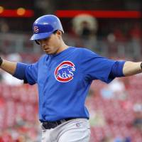 Photo -   Chicago Cubs' Bryan LaHair claps his hands at home plate after hitting a solo home run off Cincinnati Reds pitcher Bronson Arroyo during the second inning of a baseball game Wednesday, May 2, 2012, in Cincinnati. (AP Photo/David Kohl)
