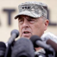 Photo - Lt. Gen. Mark Milley talks to the media near Fort Hood's main gate, Thursday, April 3, 2014, in Fort Hood, Texas. A soldier opened fire Wednesday on fellow service members at the Fort Hood military base, killing three people and wounding 16 before committing suicide. (AP Photo/Eric Gay)