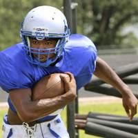Photo - Guthrie High School's Kelyn Hinds runs a drill during practice in Guthrie, Friday  August  15, 2014. Photo By Steve Gooch, The Oklahoman