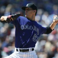 Photo - Colorado Rockies relief pitcher Chrsitian Friedrich works against the San Francisco Giants in the seventh inning of the Giants' 4-2 victory in a baseball game in Denver on Monday, Sept. 1, 2014. The game was resumed in the bottom of the sixth inning of play when it was suspended because of rain on May 22. (AP Photo/David Zalubowski)