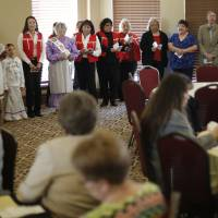 Photo - Members of the Oklahoma City Muscogee (Creek) Association sing during the Native American Heritage Celebration on Monday. Photo by Doug Hoke, The Oklahoman