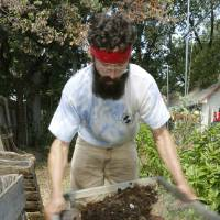 Photo -  David Braden sifts compost in his garden in Oklahoma City. Photo by Paul Hellstern, The Oklahoman   PAUL HELLSTERN -