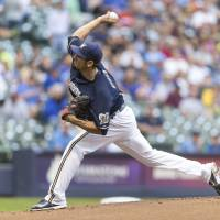 Photo - Milwaukee Brewers' Matt Garza pitches to a New York Mets batter during the first inning of a baseball game on Thursday, July 24, 2014, in Milwaukee. (AP Photo/Tom Lynn)