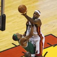 Photo -   Miami Heat's LeBron James (6) drives to the basket over Boston Celtics' Paul Pierce (34) during the second half of Game 7 of the NBA basketball playoffs Eastern Conference finals, Saturday, June 9, 2012, in Miami. At bottom is Kevin Garnett (5). AP Photo/Wilfredo Lee)