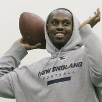 Photo - New England Patriots defensive end Chandler Jones throws a pass prior to a NFL football practice in Foxborough, Mass., Wednesday, Dec. 26, 2012. The Patriots host the Miami Dolphins on Sunday. (AP Photo/Elise Amendola)