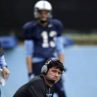 Photo - In this photo taken Wednesday, April 9, 2014 North Carolina assistant head coach for offense and tight ends Seth Littrell watches during an NCAA college football spring practice in Chapel Hill, N.C. After spending the last two seasons at Indiana, Littrell is preparing for his first season with the Tar Heels. (AP Photo/Gerry Broome)