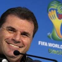 Photo - Australia's head coach Ange Postecoglou smiles during a press conference the day before the group B World Cup soccer match between Chile and Australia in the Arena Pantanal in Cuiaba, Brazil, Thursday, June 12, 2014. (AP Photo/Michael Sohn)