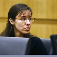 Photo - Defendant Jodi Arias looks to her family during closing arguments during her trial on Friday, May 3, 2013 at Maricopa County Superior Court in Phoenix.  Arias is charged with first-degree murder in the stabbing and shooting death of Travis Alexander, 30, in his suburban Phoenix home in June 2008. (AP Photo/The Arizona Republic, Rob Schumacher, Pool)