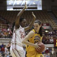 Photo - Central Michigan's Jessica Schroll, right, drives to the basket against Oklahoma's Sharane Campbell during the first half of a first-round game in the women's NCAA college basketball tournament Saturday, March 23, 2013, in Columbus, Ohio. (AP Photo/Jay LaPrete) ORG XMIT: OHJL102