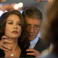 Photo - This film image released by 20th Century Fox shows Catherine Zeta-Jones, left, and Russell Crowe in a scene from