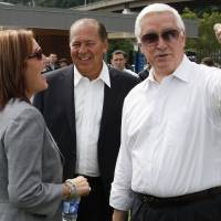 Photo - Pennsylvania Governor Tom Corbett, right, visits with West Virginia Governor Earl Ray Tomblin, center, and Ohio Lt. Governor Mary Taylor while attending a rally to support American energy and jobs in the coal and related industries at Highmark Stadium in downtown Pittsburgh, Wednesday, July 30, 2014. The rally is being held the day before the Environmental Protection Agency conducts public hearings on its new emissions regulations for existing coal fired power plants. (AP Photo/Gene J. Puskar)