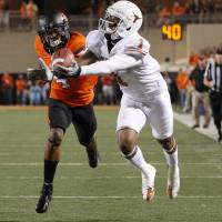 Photo - Texas' Mike Davis (1) can't hold on for the catch in front of Oklahoma State's Justin Gilbert (4) during a college football game between Oklahoma State University (OSU) and the University of Texas (UT) at Boone Pickens Stadium in Stillwater, Okla., Saturday, Sept. 29, 2012. Oklahoma State lost 41-36. Photo by Bryan Terry, The Oklahoman