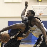 Photo - Oklahoma City guard James Harden, left, shown here during a game earlier this week, and the Thunder lost their final Orlando summer league game, 70-60, to the Utah Jazz on Friday. AP PHOTO