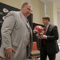 Photo - New Kansas City Chiefs NFL team head football coach Andy Reid, left, and owner Clark Hunt leave the stage after a news conference at Arrowhead Stadium Monday, Jan. 7, 2013, in Kansas City, Mo. (AP Photo/Charlie Riedel)