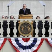 Photo - Missouri Gov. Jay Nixon delivers his inaugural address after being sworn in to a second term Monday, Jan. 14, 2013, in Jefferson City, Mo. (AP Photo/Jeff Roberson)