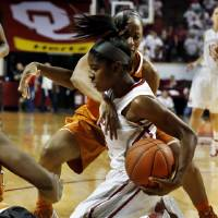 Photo - Oklahoma Sooners' Aaryn Ellenberg (3) and Texas Longhorn 's Empress Davenport, back, fight for a loose ball as the University of Oklahoma Sooners (OU) play the University of Texas (UT) Longhorns in NCAA, women's college basketball at The Lloyd Noble Center on Saturday, Jan. 19, 2013 in Norman, Okla. Photo by Steve Sisney, The Oklahoman