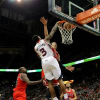 Photo - Atlanta Hawks shooting guard Louis Williams (3) dunks in the first half of an NBA basketball game against the Chicago Bulls, Saturday, Dec. 22, 2012, in Atlanta. (AP Photo/Todd Kirkland)