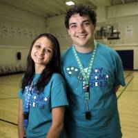 Photo - Brazilian students Danielle Cardoso and Gabriel Marques, who are working at YMCA summer camps in Oklahoma, said fast food is expensive and bank drive-up windows don't exist where they come from.  Photo by KT KING, The Oklahoman  KT King - KT KING