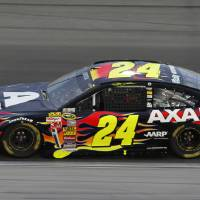 Photo - Jeff Gordon (24) takes a lap during a NASCAR Sprint Cup Series auto race at Kansas Speedway in Kansas City, Kan., Saturday, May 10, 2014. (AP Photo/Colin E. Braley)