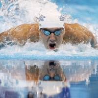 Photo -   Michael Phelps swims to victory in the men's 100-meter butterfly final at the U.S. Olympic swimming trials on Sunday, July 1, 2012, in Omaha, Neb. (AP Photo/Mark Humphrey)