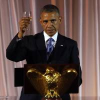 Photo - President Barack Obama offers a toast at a dinner for the U.S. Africa Leaders Summit, on the South Lawn of the White House,Tuesday, Aug. 5, 2014. African heads of state are gathering in Washington for an unprecedented summit to promote business development. (AP Photo/Charles Dharapak)