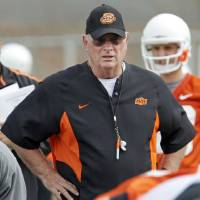 Photo - OSU defensive coordinator Bill Young watches the Cowboys during spring practice for the Oklahoma State University (OSU) college football team at the practice field in Stillwater, Okla., Monday, March 9, 2009. PHOTO BY NATE BILLINGS, THE OKLAHOMAN ORG XMIT: KOD