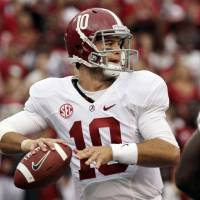 Photo -   Alabama quarterback AJ McCarron passes during the first quarter of an NCAA college football game against Arkansas in Fayetteville, Ark., Saturday, Sept. 15, 2012. (AP Photo/Danny Johnston)