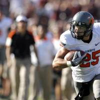 Photo - OKLAHOMA STATE UNIVERSITY: Oklahoma State's Josh Cooper (25) runs up field in the second half during a college football game between the Oklahoma State Cowboys (OSU) and the Texas A&M Aggies at Kyle Field in College Station, Texas, Saturday, Sept. 24, 2011. Photo by Sarah Phipps, The Oklahoman  ORG XMIT: KOD
