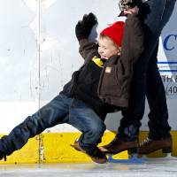 Photo - Weston Setzer, 5, gets assistance from his grandmother Rhonda Zimmer as they skate at the outdoor ice rink at Andrews Park in Norman. PHOTO BY STEVE SISNEY, THE OKLAHOMAN  STEVE SISNEY