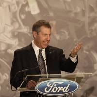 Photo - Joe Hinrichs, Ford's President of the Americas, announces plans to build the 2.0-liter EcoBoost engine at the Ford Cleveland Engine Plant, Thursday, Feb. 21, 2013, in Brook Park, Ohio. Ford is moving production of a popular small engine from Spain to Cleveland as sales of four-cylinder motors continue to rise. (AP Photo/Tony Dejak)