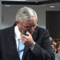 Photo - In this screen grab from a DHS recording, DHS Director Howard Hendrick wipes away tears Tuesday after announcing his retirement.