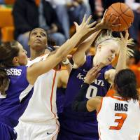 Photo - From left, Kansas State's Brittany Chambers (2), Oklahoma State's Toni Young (15), Kansas State's Heidi Brown (10) and Oklahoma State's Tiffany Bias (3) battle for a rebound during an NCAA women's basketball game between Oklahoma State University (OSU) and Kansas State at Gallagher-Iba Arena in Stillwater, Okla., Saturday, Feb. 16, 2013. Photo by Nate Billings, The Oklahoman