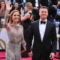 Photo - FILE - In this Sunday, March 2, 2014, file photo, Angelina Jolie, left, and Brad Pitt arrive at the Oscars at the Dolby Theatre in Los Angeles. Jolie and Pitt were married Saturday, Aug. 23, 2014, in France, according to a spokesman for the couple. (Photo by Vince Bucci/Invision/AP, File)