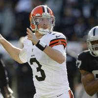 Photo - Cleveland Browns quarterback Brandon Weeden (3) passes against the Oakland Raiders during the first quarter of an NFL football game, Sunday, Dec. 2, 2012, in Oakland, Calif. (AP Photo/Tony Avelar)