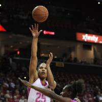 Photo - Maryland's Alyssa Thomas (25) shoots over Clemson's Nikki Dixon in the first half of an NCAA women's college basketball game, Sunday, Feb. 9, 2014, in College Park, Md. (AP Photo/Gail Burton)