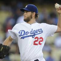 Photo - Los Angeles Dodgers starting pitcher Clayton Kershaw throws against the Chicago White Sox during the first inning of a baseball game on Monday, June 2, 2014, in Los Angeles. (AP Photo/Jae C. Hong)